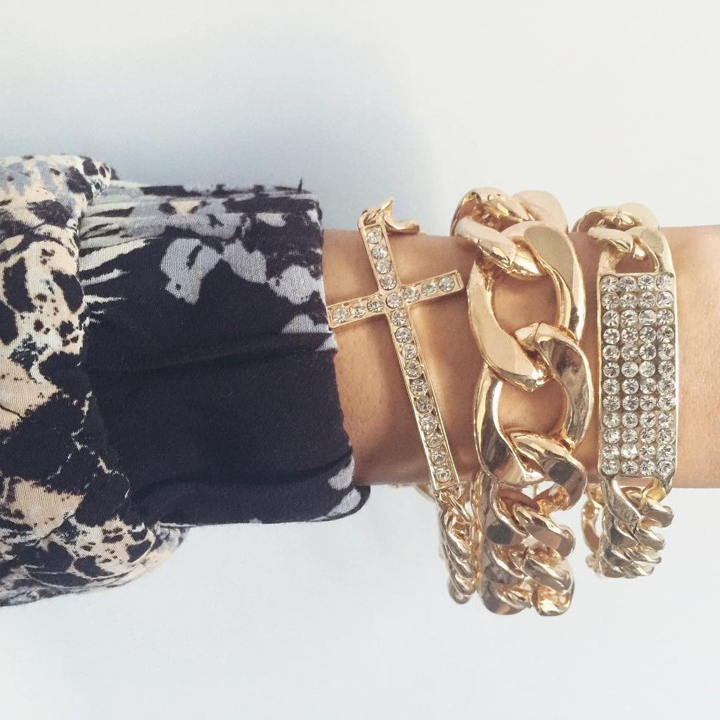Thick gold chain with other chain bracelets exclusively at