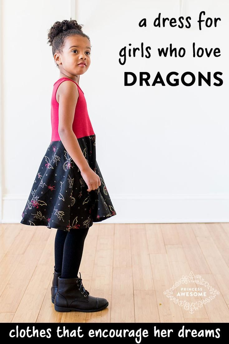 Watch out! Fierce, beautiful dragons circle this print, breathing fire of scarlet and sparkling gold. Your awesome girl will always be in control of these beasts, commanding them to fly - wings outspread - with every twirl of her skirt. With pockets for storing treasures and a deep red top, this dress is sure to be a favorite of your Little Dragon Tamer.   Sizes 2T, 3T, 4T, 5, 6, 8, 10, 12.