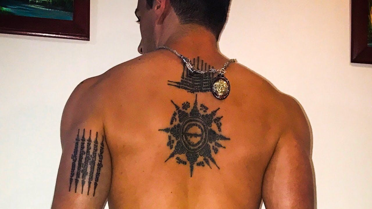 Muay thai tattoo symbols and meanings thai tattoo muay thai find out the meanings of muay thai tattoo symbols learn about traditional sak yant tattoos like five lines twin tigers nine peaks eight directions and buycottarizona Images