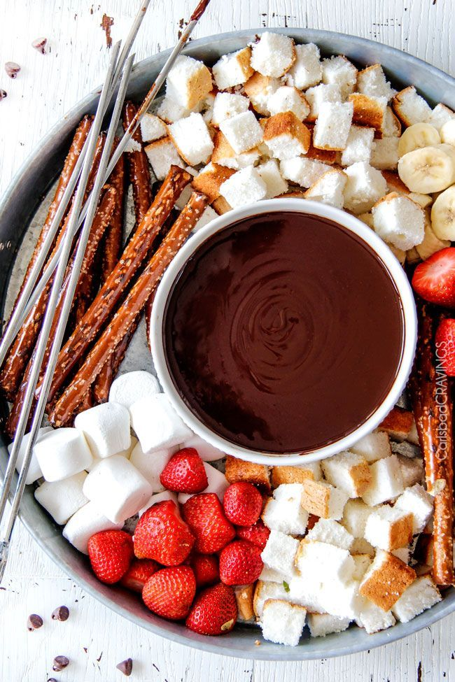 Slow Cooker Chocolate Fondue - EASY, velvety chocolate is the perfect make ahead party or special occasion appetizer or dessert. Perfect for Valentine's Day or baby/bridal showers! #fondueparty