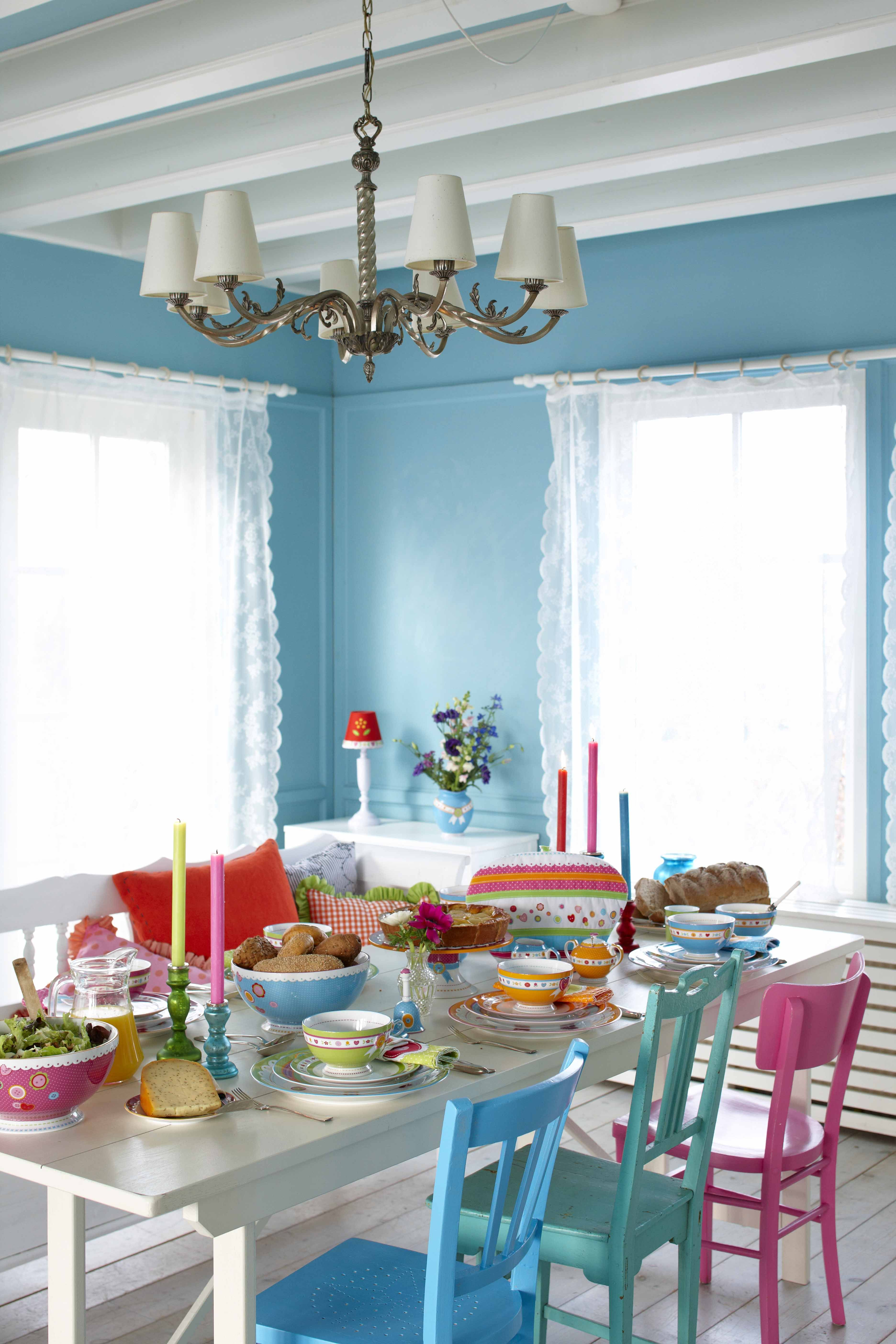 like the blue of the walls and the different colours of Colorful Parson Chairs Retro Chic Dining Room
