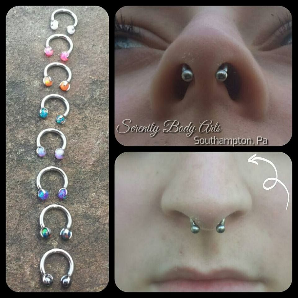 Piercing through bridge of nose  Healed septum piercing with a classic circular barbell from