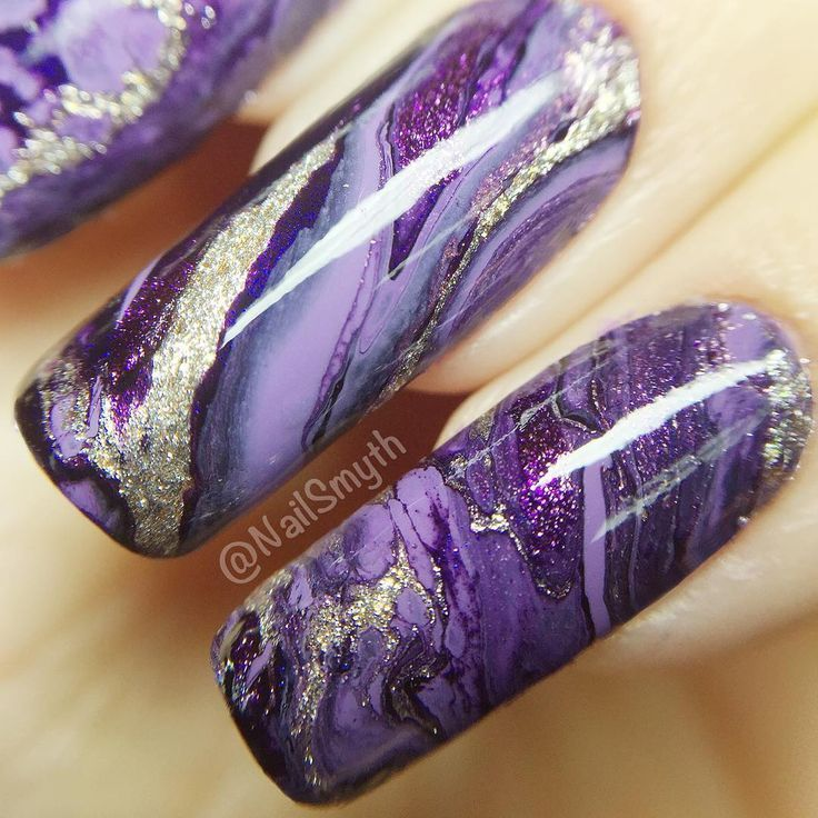 Photo of purple agate/geode nails
