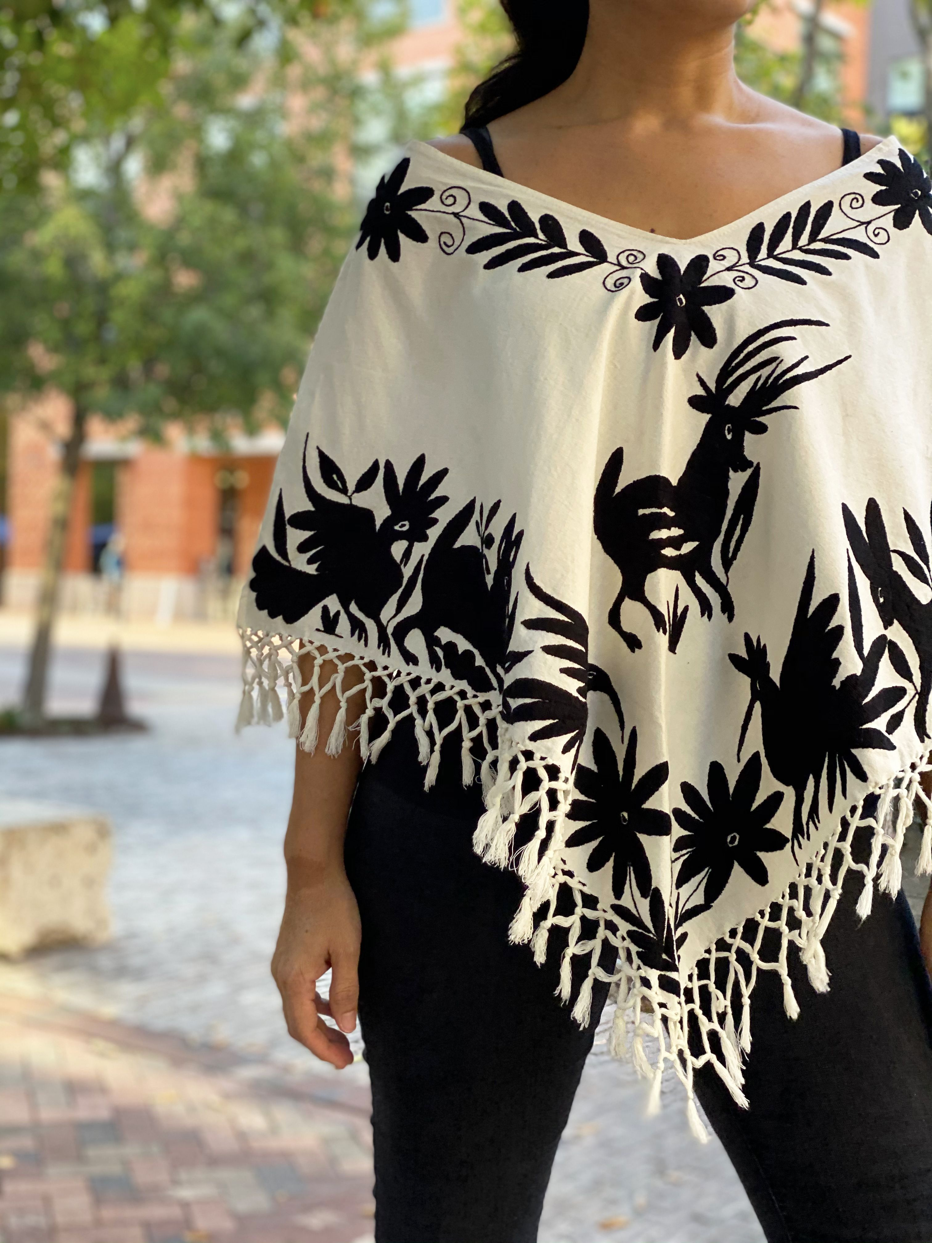 Beautiful Mexican embroidered striped blouse.
