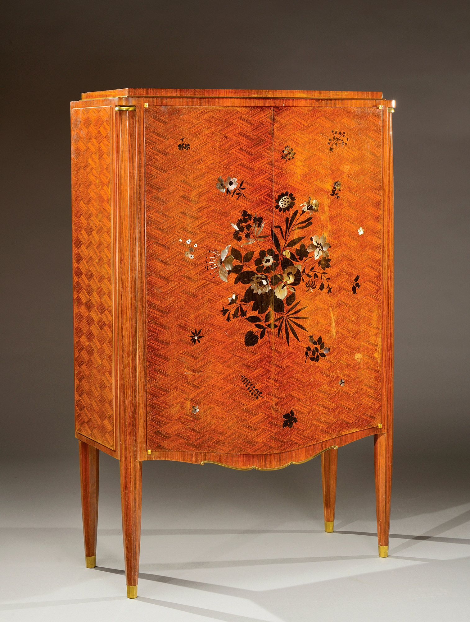 jules leleu 1883 1961 a rosewood of the indies veneer cupboard opening by two doors with an exotic wood and mother of pearl marquetry circa 1930 1940