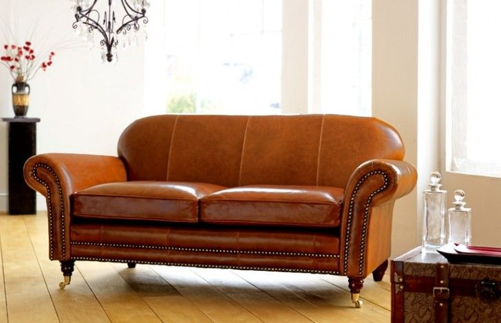 The Rochester vintage leather settee is an elegant Leather settee on wooden Legs, a great example of what is best about vintage English Sofas. Taking its inspiration from the classic chesterfield sofas, the studded front and gently curved back combine effortlessly to give this vintage leather sofa a genteel appearance. This sofa design is perfect with turned legs and castors or if preferred wooden legs to all corners may be fitted.