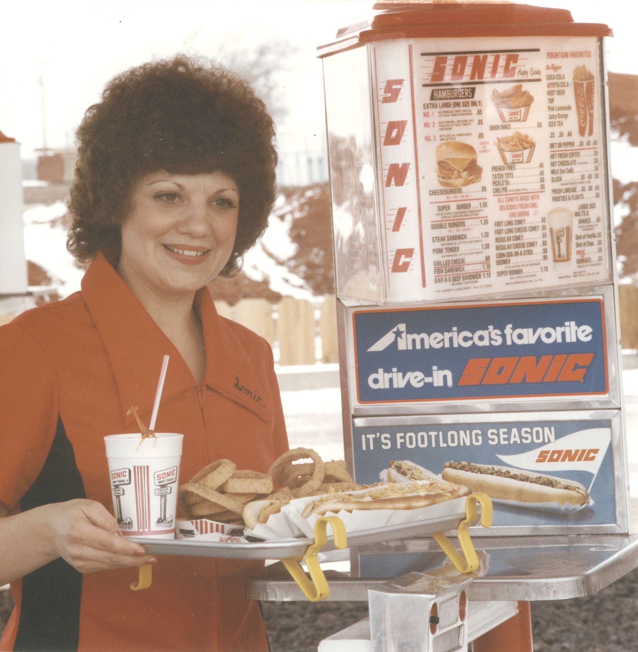 sonic carhops in a blast from the past carhop and menu board at sonic circa