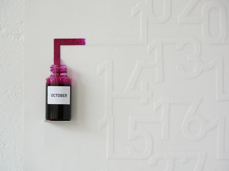 Ink Calender by Oscar Diaz: The 'Ink Calendar' uses the timed pace of the ink spreading on the paper to indicate time. The ink is absorbed slowly, and the numbers in the calendar are 'printed' daily. One a day, they are filled with ink until the end of the month. A calendar self-updated, which enhances the perception of time passing and not only signalling it - a color related to our perception of the weather on that month.
