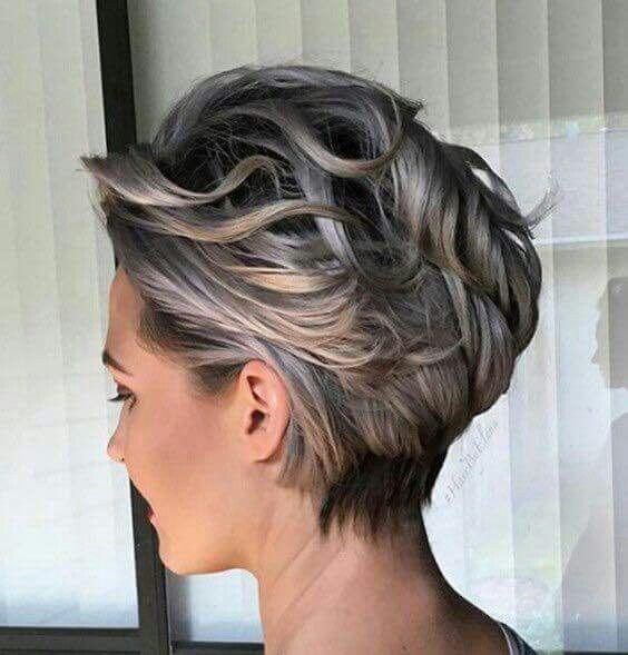 Ash blonde short wave messy haircut pixie