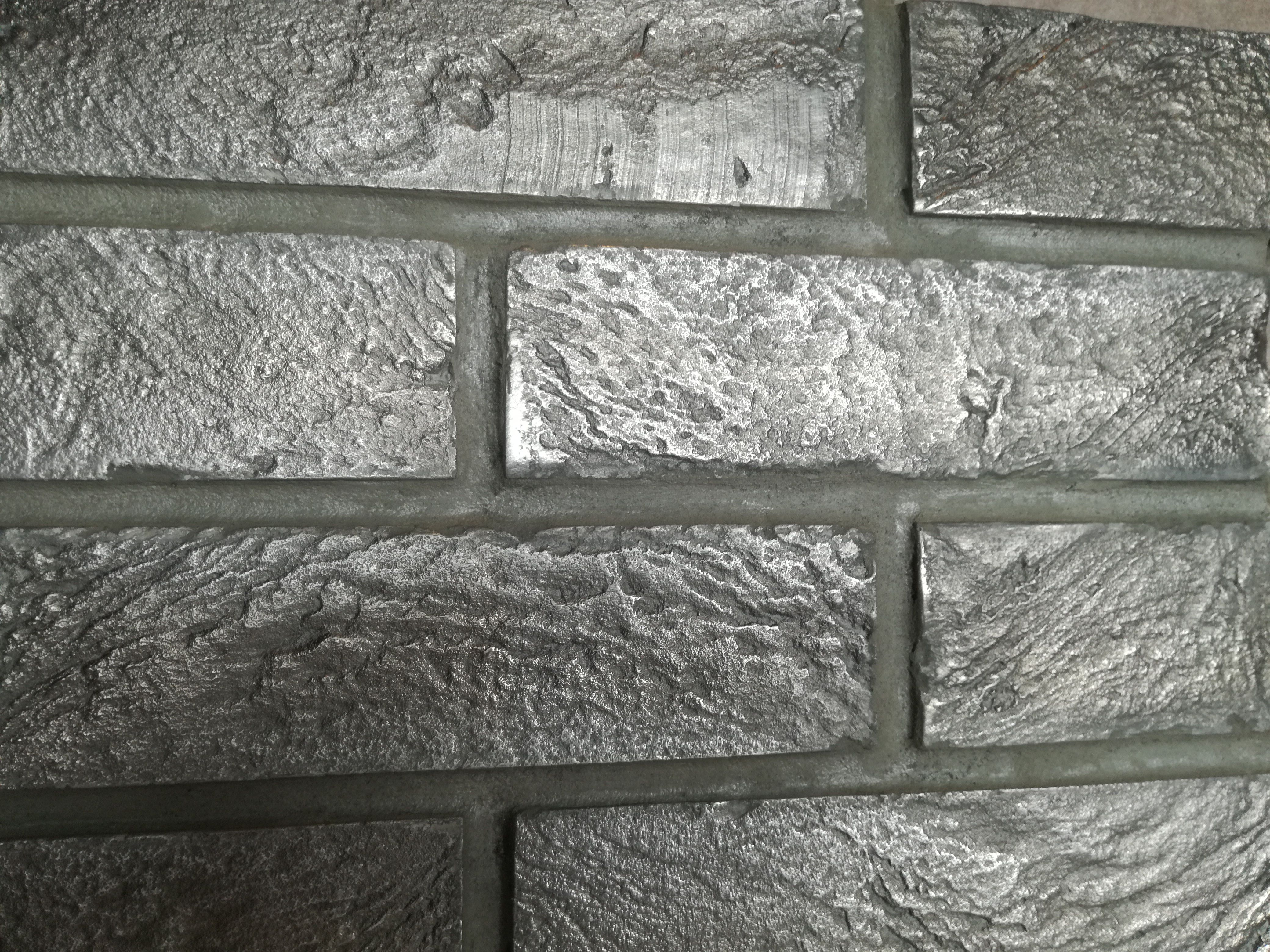 Hand Made Silver Brick Slips: a unique secret formula of cement cast and hand polished, suitable for interior and exterior designs with the exception of bathrooms.  Price: £246 / m2