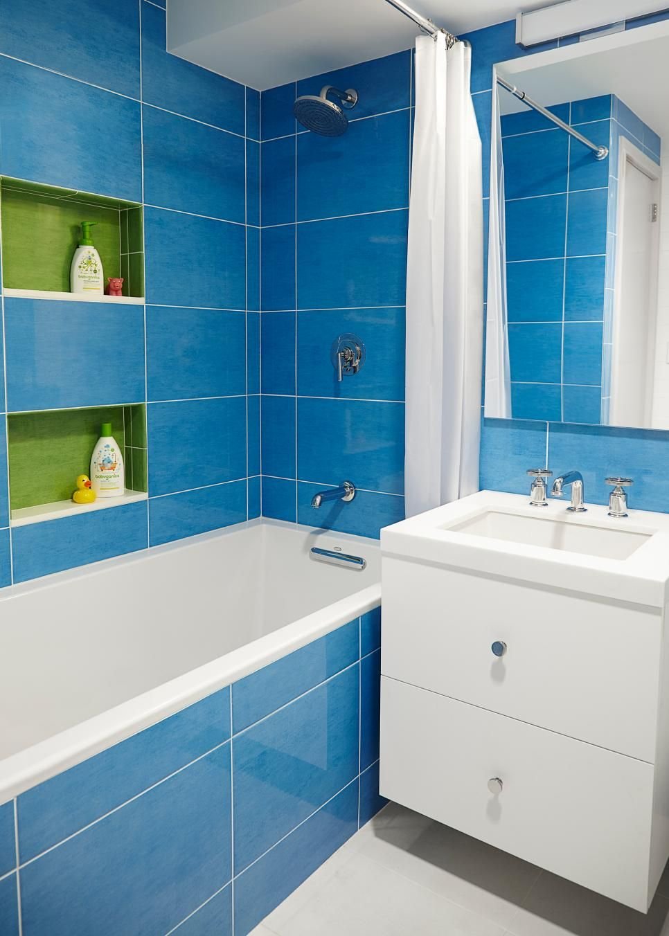How to Bring Color Into Your Home | Floating vanity, Blue tiles and Hgtv