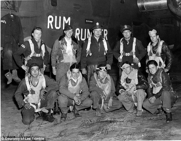 Heroes: Then Lieutenant Robert Trimble (standing, second from left) and his crew pose with their B-24 Liberator 'Rum Runner' at RAF Debach, in Suffolk, on the day of their first combat mission, 6 July 1944. The mission was to bomb a V-1 flying bomb storage site in France. Crew (l-r standing): Lt Warren Johnson; Trimble; Lt Walter Hvischuk; Lt Raymond Joseph; Sgt Joe Sarina; (l-r squatting) Sgt Julio 'Chico' Mendez; Sgt Gale D. Moore; Sgt Alton R. Stafford; Sgt Horace Grady Hendricks; Sgt ...