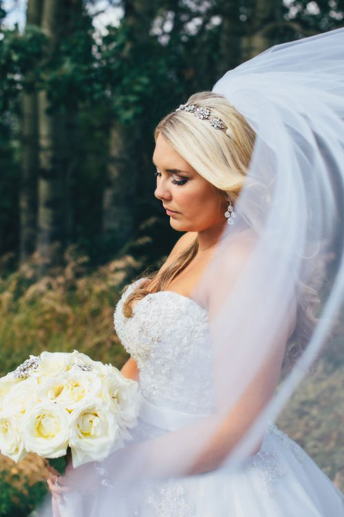 Stunning fine art wedding photography. Veil  blowing in the wind. Beautiful blonde bride. Wedding bouquet with jewels.  http://www.emilyjanephotography.ca http://www.emilyjanephotographyblog.ca