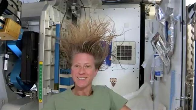 Astronaut Karen Nyberg demonstrates how she washes her long hair on International Space Station