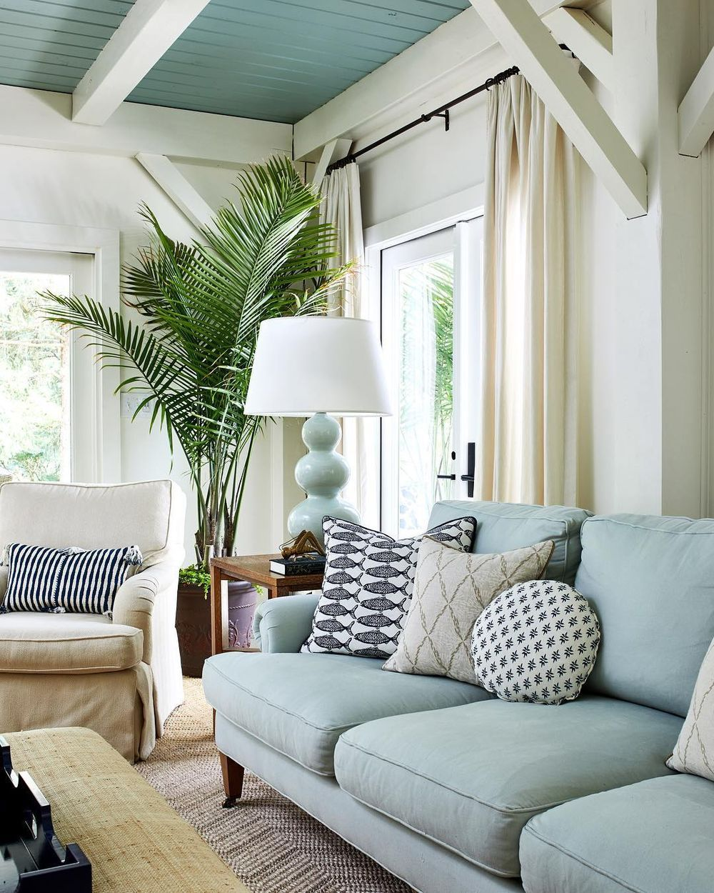 Coastal Sofas Beach Home With Blue Linen Sofa And Indoor Palm Studiomiel Light Blue Sofa Coastal Living Room Blue Living Room
