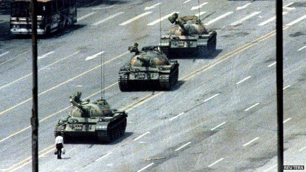 A Beijing citizen stands in front of tanks on the Avenue of Eternal Peace in this 5 June 1989 file photo during the crushing of the Tiananme...