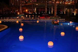 Round Floating Candle Luminaries In A Swimming Pool Blend Well With Small Votive Candles To