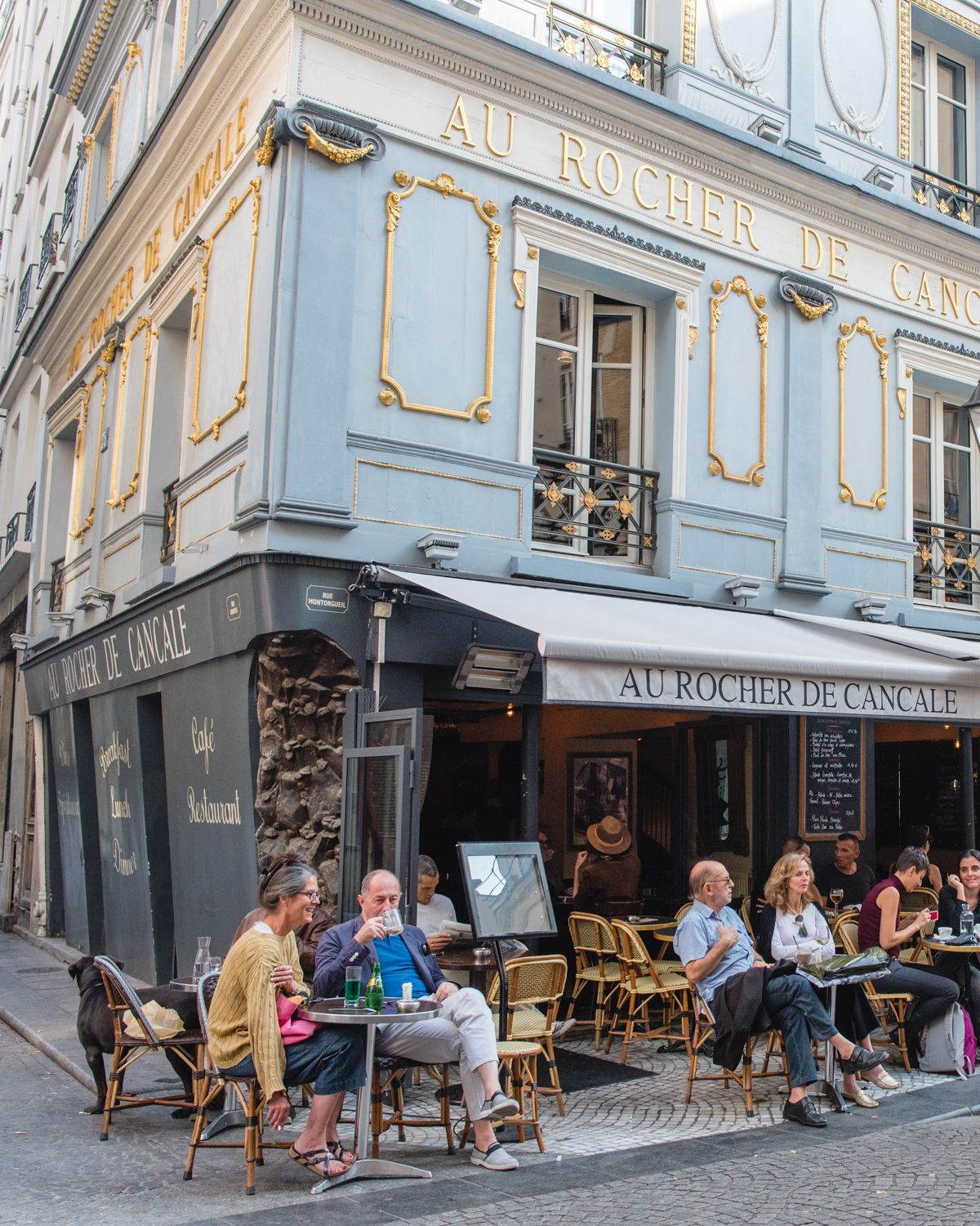Outdoor cafe in paris with tower in background - The Best Of Rue Montorgeuil In Paris Where To Eat Drink And Shop