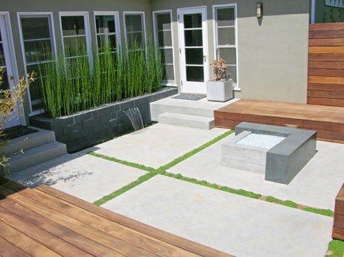 modern concrete patio fire feature