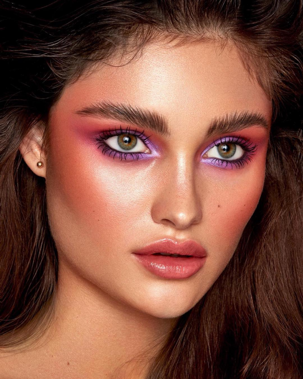 peach toned shimmery eyes, with flawless 100 watt skin and