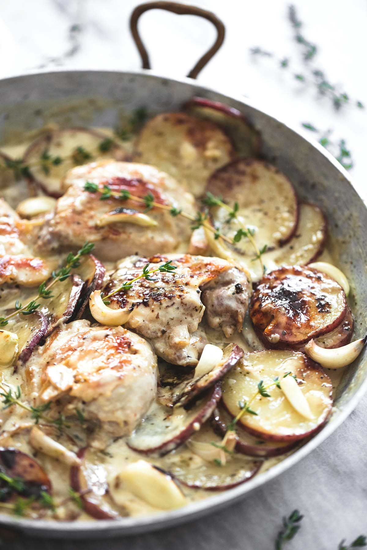One Pan Creamy Garlic Herb Chicken & Potatoes | lecremedelacrumb.com