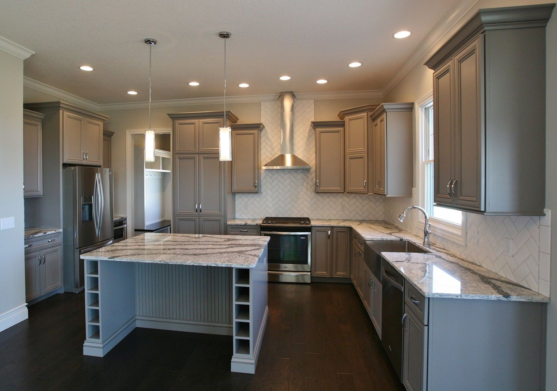 """A painted """"Fog"""" gray kitchen with large island in Bettendorf"""