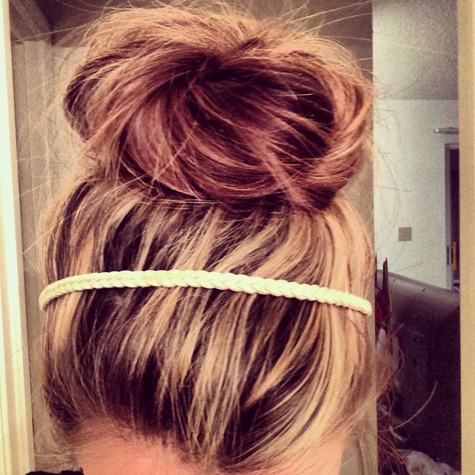 Messy bun for long thick hair. Step 1: Pull hair up as if putting ...