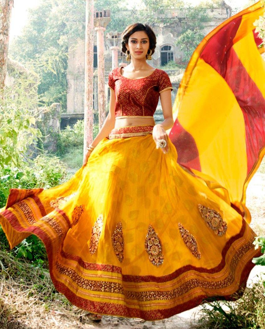 Yellow lehenga with zari and resham embroidered heavy border