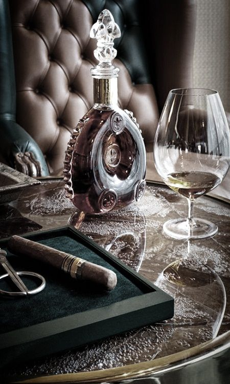 It's a man's world. Classy rich tobacco leather, antique decanter and earthy colours.