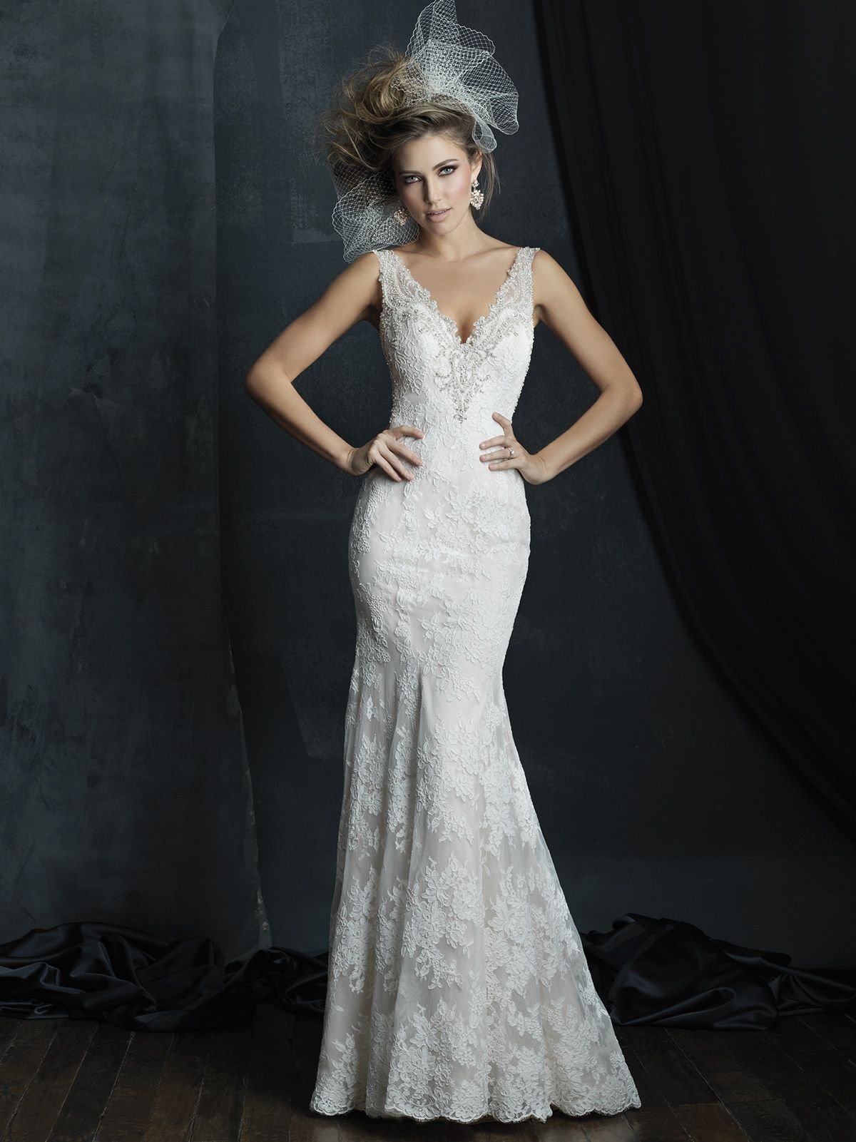 Popular Allure Bridals Couture This slim lace gown features crystalline beadwork and a delicate illusion back