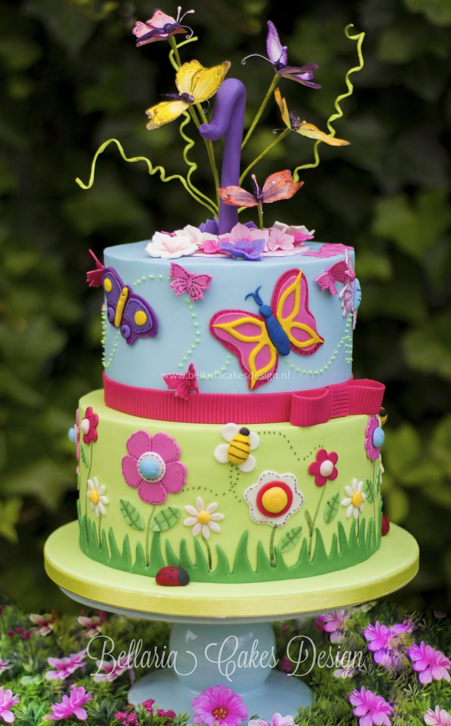 Butterflies garden themed cake for the very first Birthday