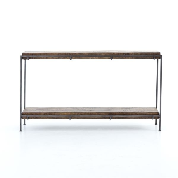 Harmon Simien Console from The Harmon Annex Collection from Four Hands features an array of occasional and dining selections in a stripped down and raw finish.The Khazana is a furniture store located in Austin, Texas.