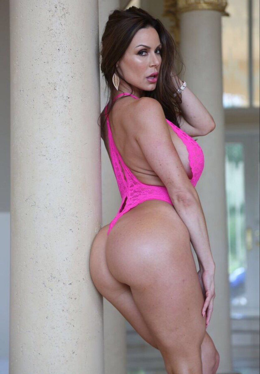 beautiful and shapely, dark-haired mature model kendra lust standing