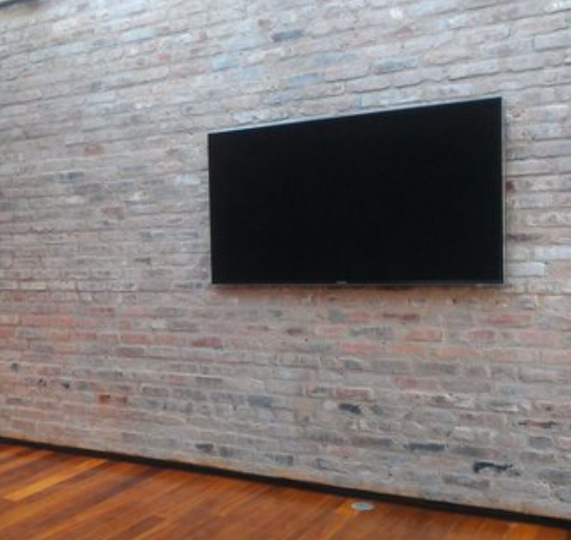 Tv mounted on brick wall with no visible cables bonus - Slanted wall tv mount ...