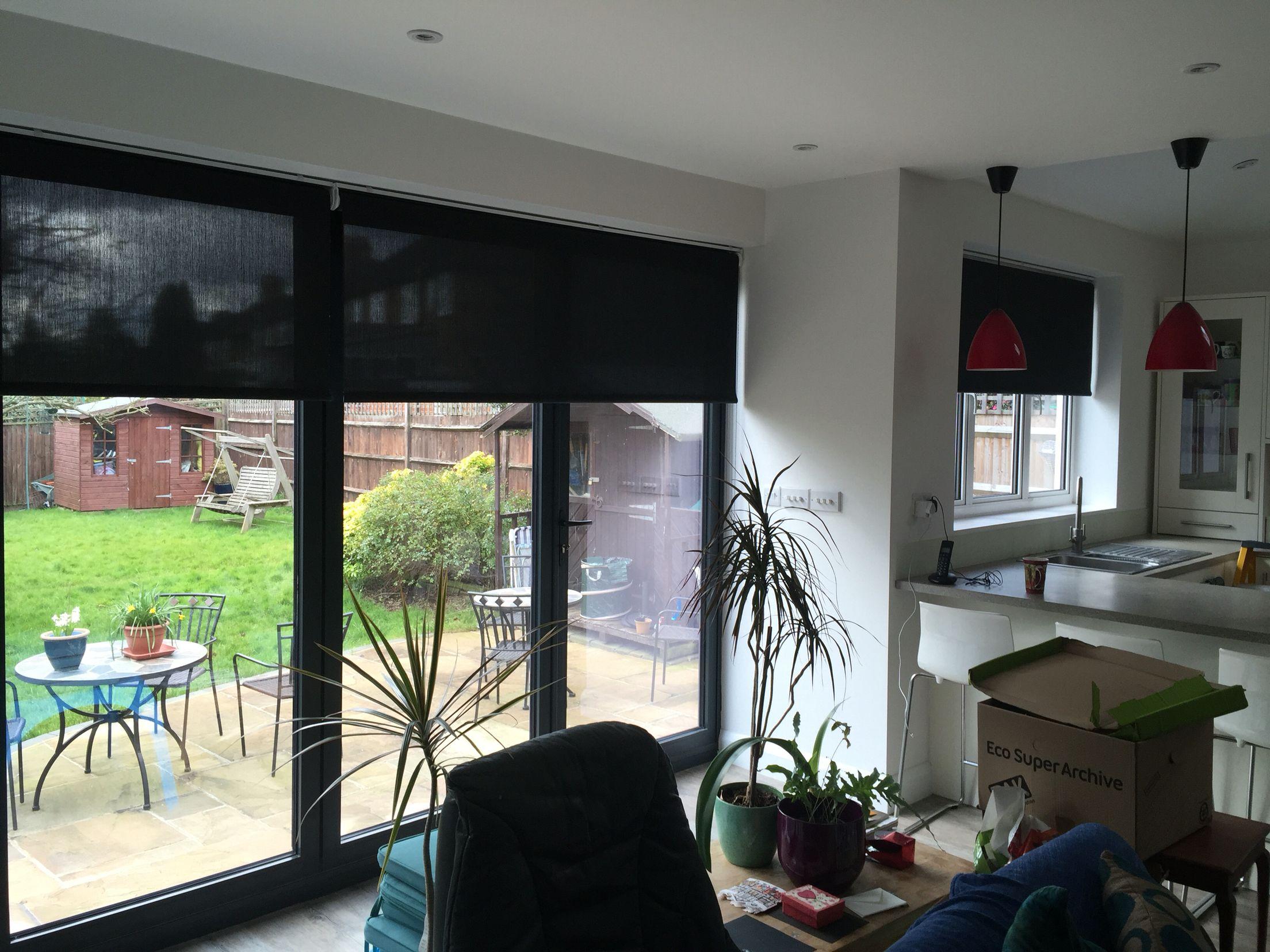 Roller Blinds Look Good On Bifold Doors Living Room