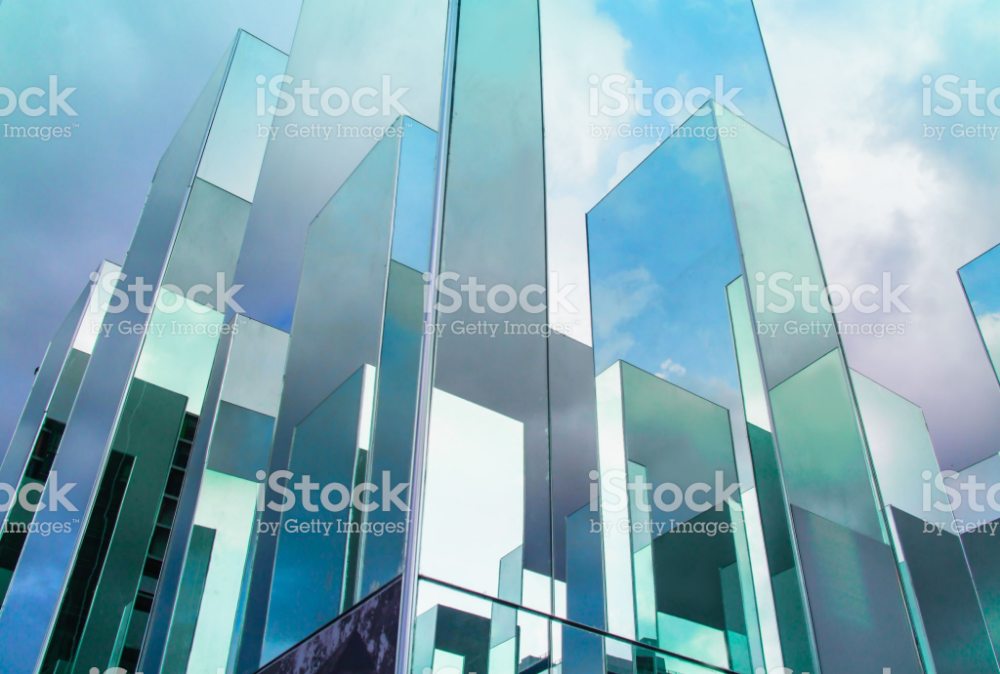Bottom View Of Reflection Of Blue Sky On Building Mirror Abstract