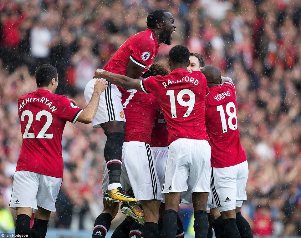 The United players celebrate taking an early lead during a