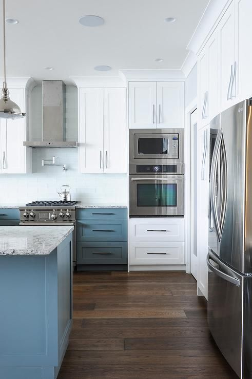 White Upper Cabinets With Blue Lower Cabinets With Pale Blue Glass Backsplash Tiles T Trendy Kitchen Backsplash Transitional Kitchen Glass Backsplash Kitchen