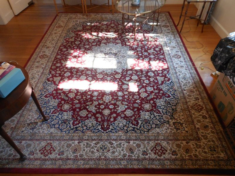 A stunning oriental rug in shades of blue, burgundy and ivory.