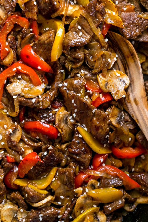 MUST TRY quick beef stir-fry recipe loaded with mushrooms, bell peppers and zucchini. Serve beef stir-fry over steamy white rice. The easy beef stir fry sauce will surprise you! #beefstirfry #stirfry #beefstirfryrecipe #easystirfy #30minutemeal #dinner #easydinner #beefrecipes #steakrecipes #steakstirfry #stirfryingredients #howtomakestirfry #natashaskitchen #healthystirfry