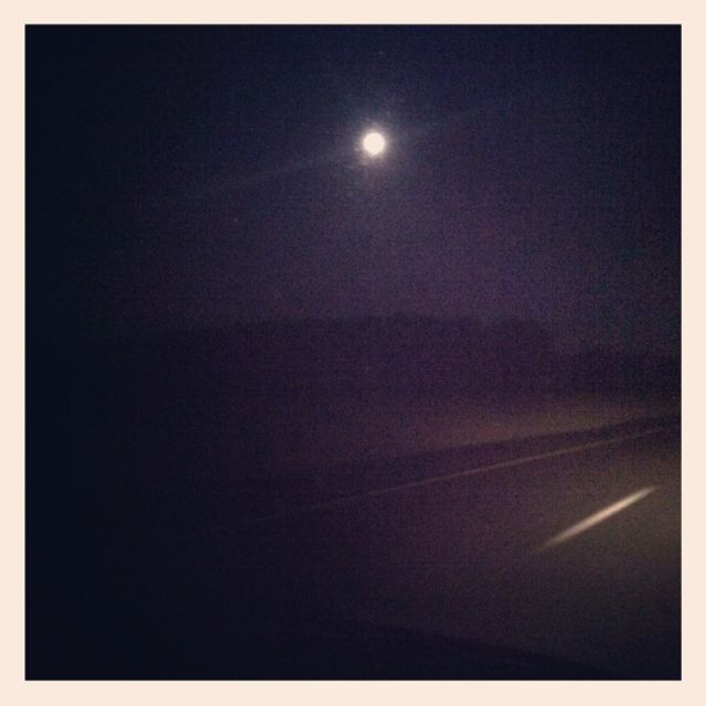 The moon up above us, the road out before us