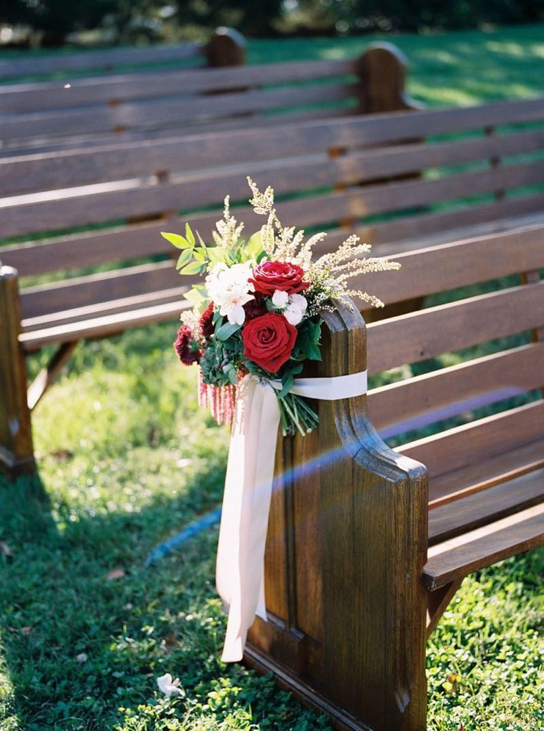 Church benches, red roses, reception décor, outdoor wedding, white ribbon, astilbe // Jenna Henderson