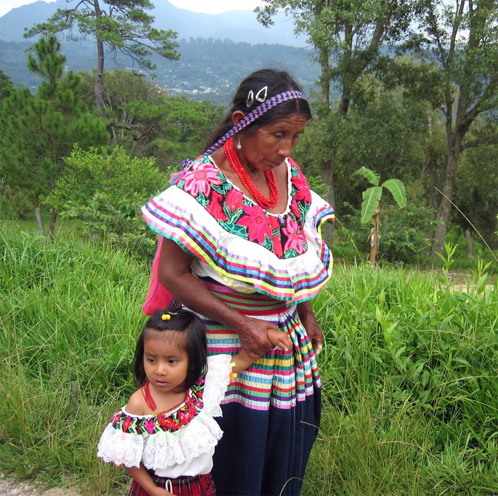 A Tojolabal Woman with a Child, Chiapas, Mexico. My son in law is from Chiapas. The little girl looks like 2 of my grands!