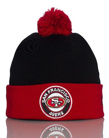 a0fe02a2ce1 NEW ERA Football knit cap Pom Pom detail on top Fold up brim Embroidered San  Francisco 49ers circle logo patch on front NEW ERA logo stitching on back