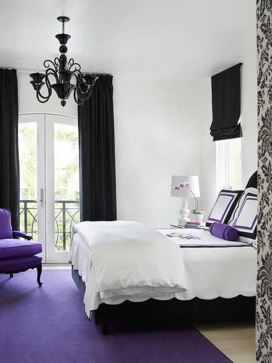 Black Bedroom Features Pure White Walls