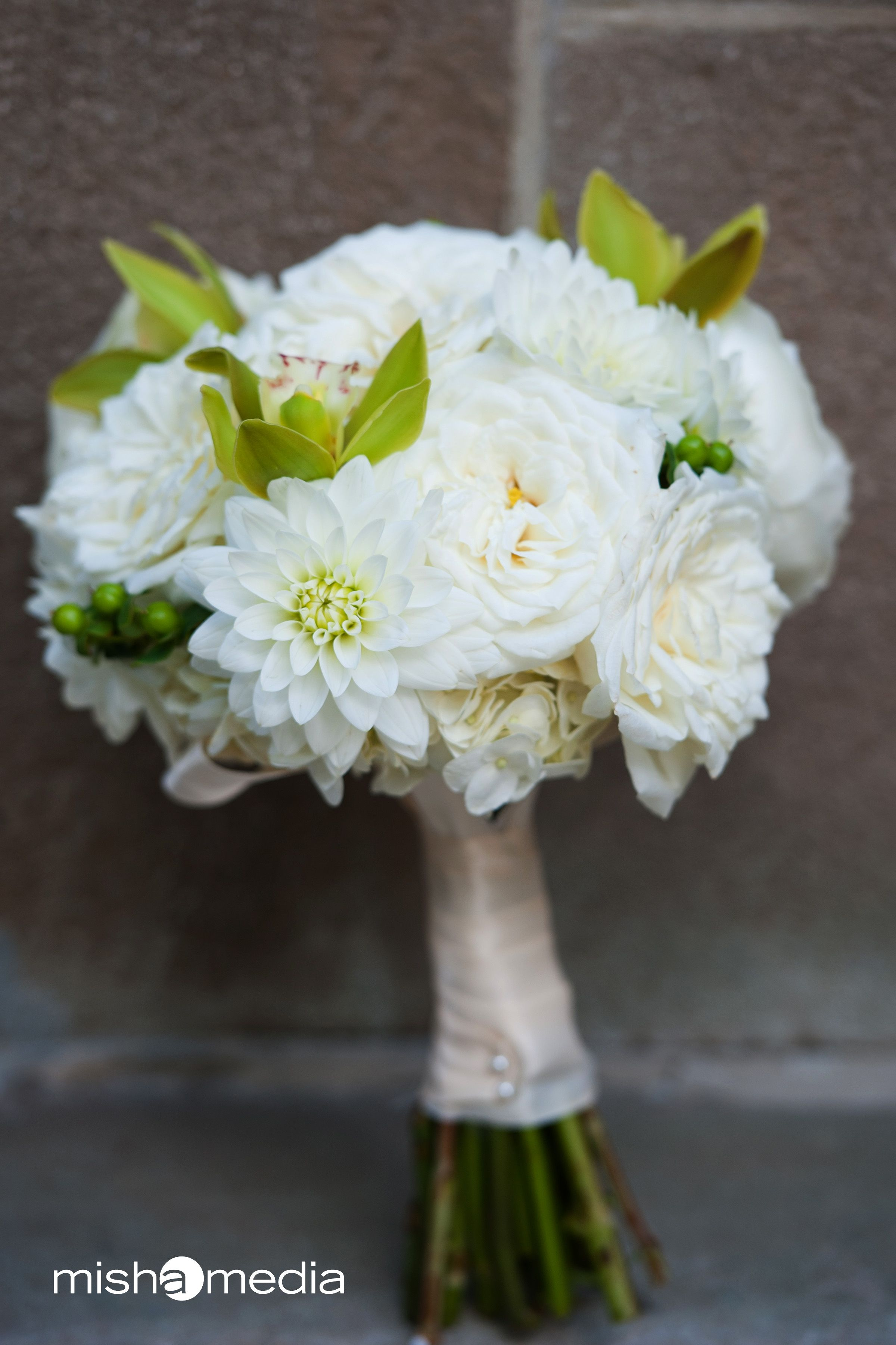 bridal bouquet of alabaster garden roses white dahlias green hypercium berries and mini green