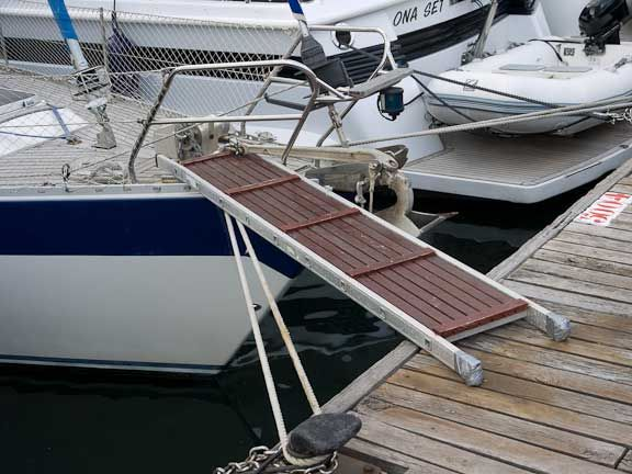 Wood Panels On A Ladder For A Dog Ramp To The Sailboat
