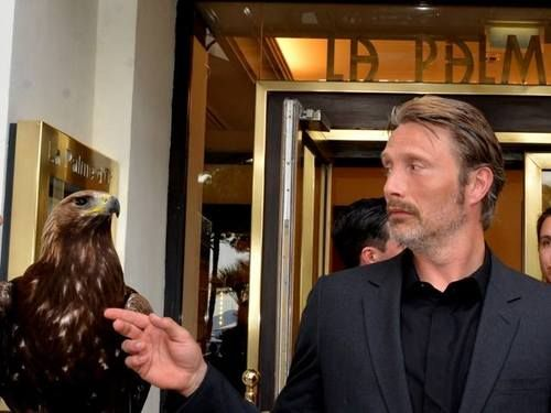 Mads Mikkelsen in front of a restaurant in Cannes, 2014