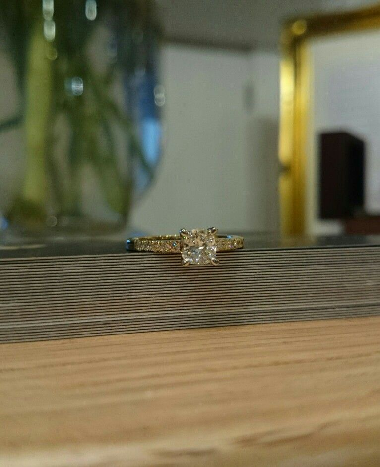 Cushion cut centre diamond, set into a glittering yellow gold band. Designed and made at Hallmark Jewellers, Titchfield.