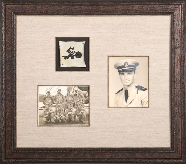 A gift from a niece to her favorite uncle, commemorating his time in the service. It combines photos and objects in one custom frame to create a family heirloom.
